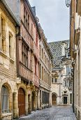 Street With Historical Half-timbered Houses In Dijon, France poster
