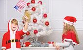 Cherished Holiday Activity. Kids In Santa Hats Decorating Christmas Tree. Family Tradition Concept.  poster