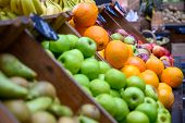 Apples, Oranges, Pears And Bananas On Display And Ready For Sale At A Fruit And Veg Stall In Borough poster
