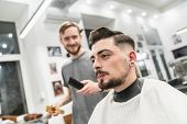 Customer Smiling In Barber Shop With Barber. Fun Barber. poster