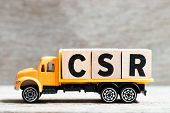 Truck Hold Letter Block In Word Csr (abbreviation Of Corporate Social Responsibility) On Wood Backgr poster