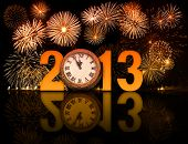 stock photo of firework display  - 2013 year with fireworks and clock displaying 5 minutes before midnight - JPG