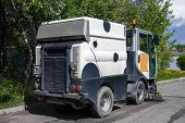The Special Car Cleans City Road. Machine Sweeper - Cleaner Cleans The Roadway. Machine Brushes Swee poster