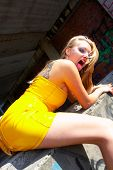 stock photo of slut  - Attractive sexy Girl in yellow latex dress - JPG