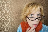 image of tawdry  - Crazy woman with glasses suspiciouly eyeing the camera - JPG