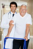 image of zimmer frame  - Young happy doctor helping an old man with his walker - JPG