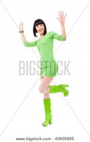 beautiful brunette girl wearing a dress jumping up