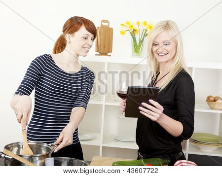 Female Friends Cooking In The Kitchen