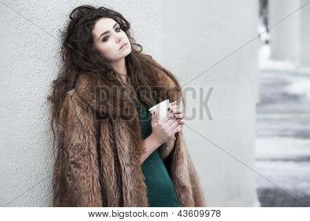 Breaktime. Attractive Thoughtful Woman Holding Coffee Cup And Relaxing