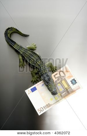 Toy Cocodrile, Aligator, With Fifty Euro Banknote In His Jaws