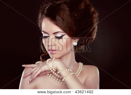 Beautiful Pretty Woman With Pearls On Her Neck Isolated On Dark Background