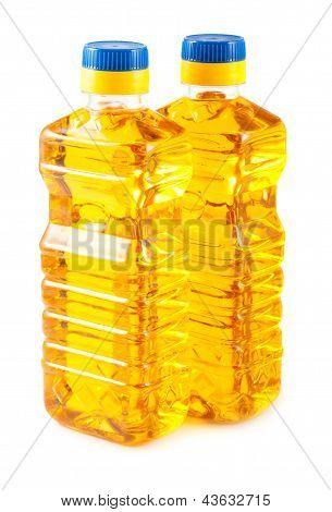Two Plastic Bottles Of Oil