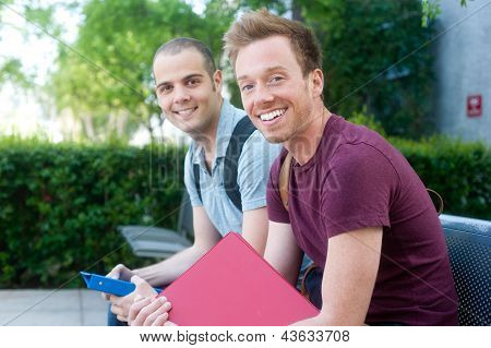 Pair Of Happy Young Male Students