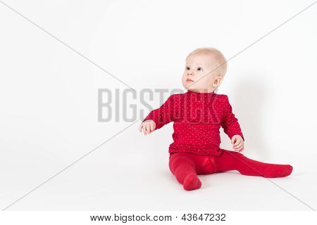 Cute Sitting Baby In Red Suite On White Background
