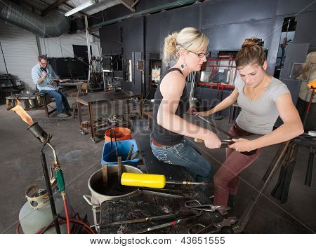 Pair Of Artisans Working With Tools