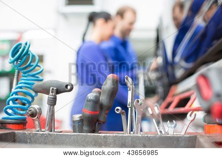 Tools In Garage Or Workshop With Mechanics