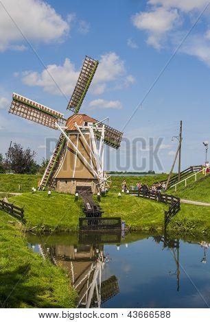 Windmill In A Sunny Dutch Landscape