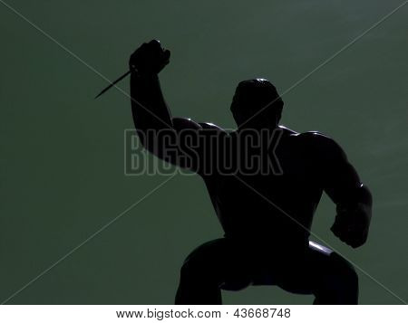 Black silhouette of a man wielding a knife