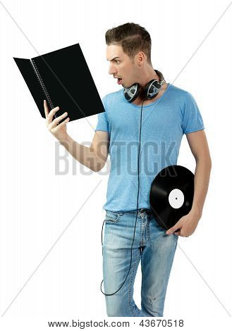 Suprised Young Deejay Holding Vinyl And Learning From Black Book