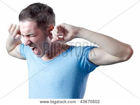 Young Man Yelling With Fingers In Ears