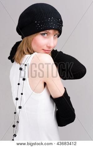 woman in knit wool hat with black necklace