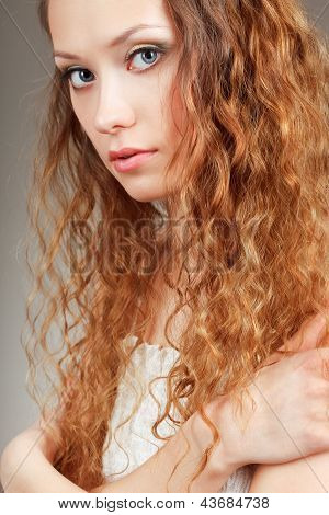 beautiful curly haired woman