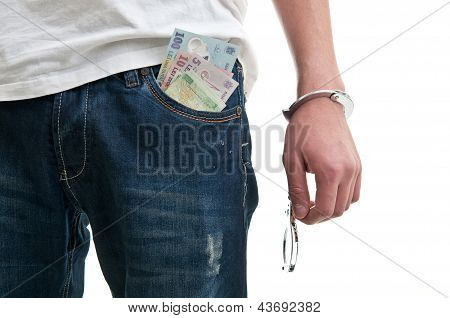 Man In Jeans With Handcuffs And Money In Pocket