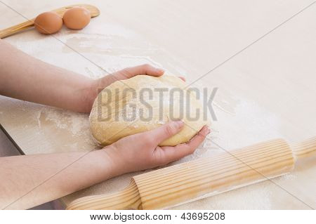 taking the dough with both hands