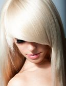 stock photo of hair streaks  - Photo of young beautiful woman with magnificent hair - JPG