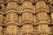 foto of kandariya mahadeva temple  - Sculptures of religious figures decorating the ancient Kandariya Mahadeva Hindu Temple at Khajuraho Uttar Pradesh India. 11th Century AD. ** Note: Slight blurriness, best at smaller sizes - JPG