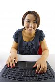 stock photo of pov  - Young Asian female on a computer viewed from the webcam - JPG