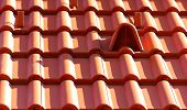 pic of aeration  - Closeup of new red roof tiles with aeration - JPG