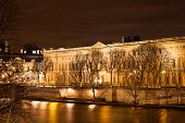 Quai Du Louvre In Paris At Night