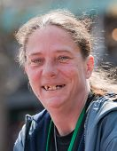 stock photo of gingivitis  - Homeless woman smiling with bad teeth - JPG