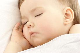 picture of sleeping baby  - Cute child sleep with hand under his cheek high key portrait - JPG