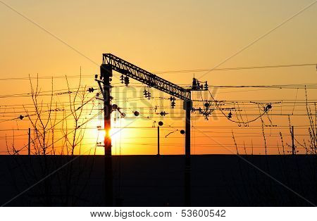 Railway Electric Cables And Wires At Sunset