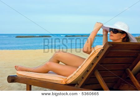 Lady With White Hat On The Beach