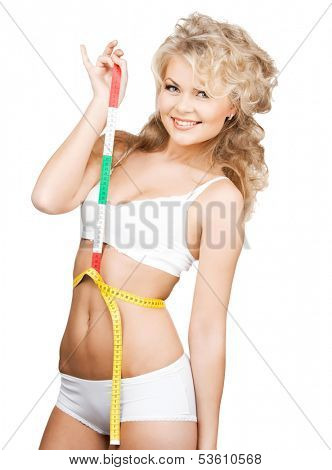 health, beauty, weightloss, diet concept - woman measuring her waist with tape