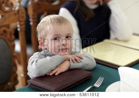 Child Resting At Cafe