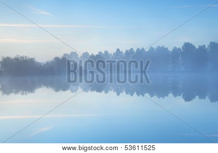 Tranquil Misty Morning On Lake