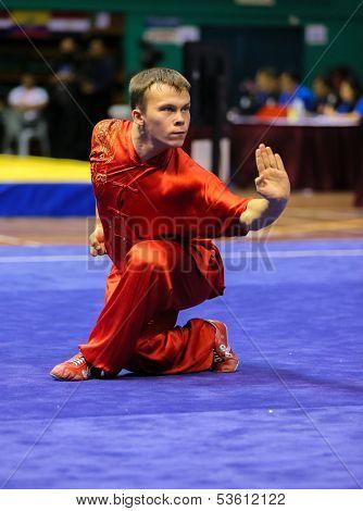 KUALA LUMPUR - NOV 03: Russia's Ilyas Khusnutdinov shows his fighting style in the 'changquan compulsory' event at the 12th World Wushu Championship on November 03, 2013 in Kuala Lumpur, Malaysia.