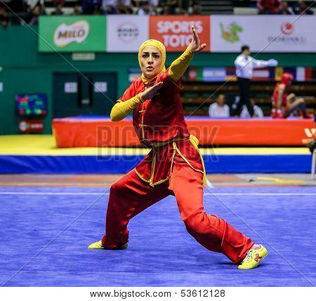 KUALA LUMPUR - NOV 03: Hanieh Rajabi of Iran shows her fighting style in the 'changquan compulsory' event at the 12th World Wushu Championship on November 03, 2013 in Kuala Lumpur, Malaysia.