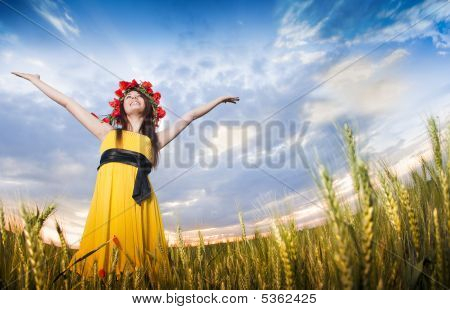 Beautiful Young Girl In The Wheat Field