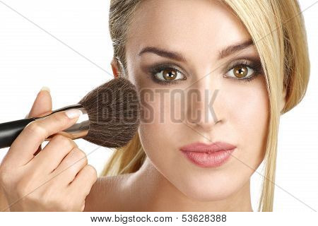 Beautiful Model Applying Professional Make Up Using A Brush