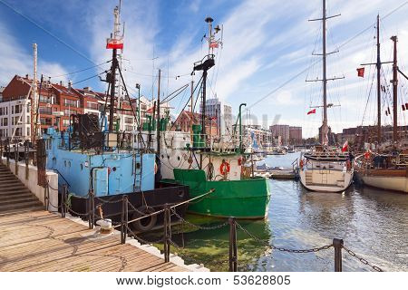GDANSK, POLAND - 29 OCT 2013: Harbor at Motlawa river in old town of Gdansk on 29 October 2013. Gdansk is a Polish city on the Baltic coast, one of the main seaport and center of Tri City area.