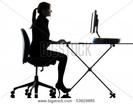 one business woman computer computing typing  silhouette studio isolated on white background