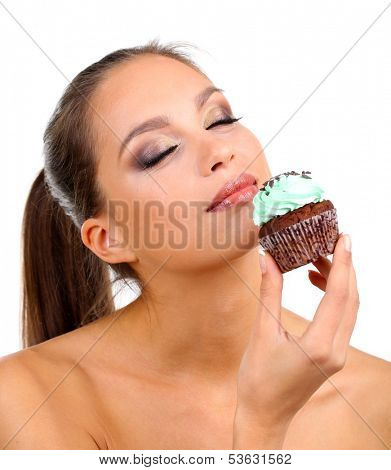 Portrait of beautiful young girl with chocolate cupcake isolated on white