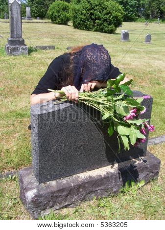 Mourning Woman At Headstone