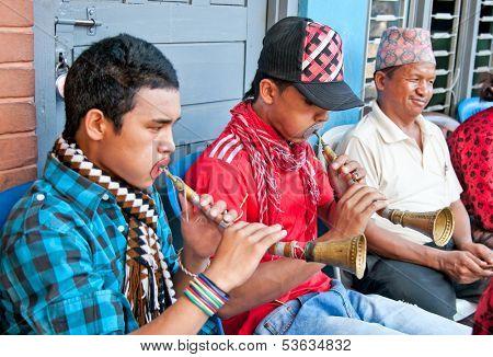 POKHARA, NEPAL-MAY 25. 2013: An unidentified Nepalese street musicians play brass trumpet May 25, 2013 in Pokhara, Nepal. Pokhara is located about 210 km nort-west of Kathmandu.