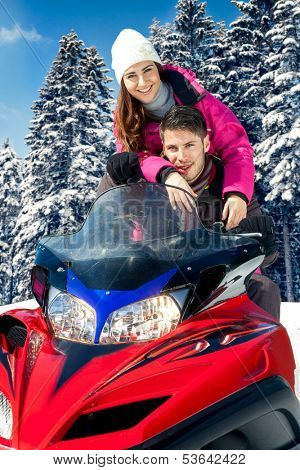 Young couple on snowmobile